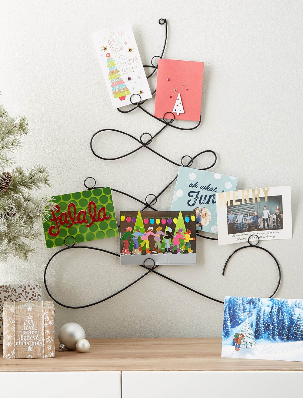 Fresh ideas for holiday card displays container stories create holiday wall dcor that can transform for year round use with our black tree wall cardholder secure holiday cards and photos within its 12 loops m4hsunfo