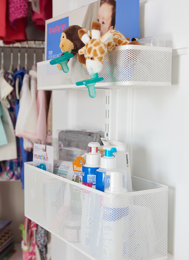 Small Nursery Closet Organization Ideas Part - 31: The Adjustable Elfa Door And Wall Rack Gives Katie A Lot Of Flexibility To  Store Everything From Supplies To Small Toys.